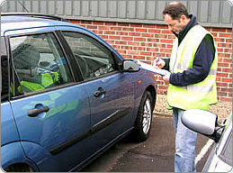 A VehicleSpa Inspector evaluates a Leased Vehicle